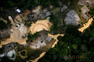 A gold prospectors camp pollutes a stream in the Amazon rainforest.