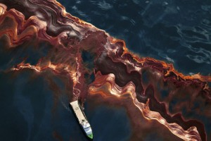 A ship cuts through a band of oil on the surface of the water. Asubstantial layer of oily sediment stretches for dozens of miles in all directions from the wellhead, suggesting that a large amount of oil did not evaporate or dissipate, but may have inste