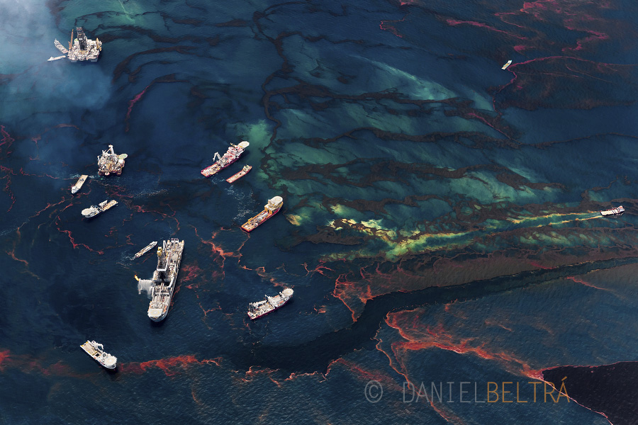 Boats gather near remaining oil platforms near the site of the Deepwater Horizon wellhead, leaving oily wakes as they move through the polluted water. Nearly one third of all U.S. oil production comes from 3,500 such platforms in the Gulf of Mexico.