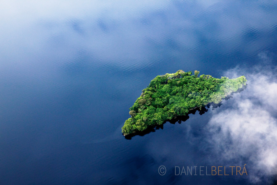 A small island in Lake Mai-Ndombe is revealed through the cloud cover in central region of the Democratic Republic of Congo.