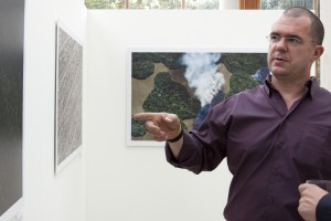 Daniel Beltrá gives an artist talk at an exhibit of his work for the Prince's Rainforests Project, Kew Gardens, London, September 2009.